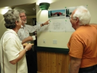 Penny Alex and Paul at Open House reviewing Slocan Housing Project Concept drawings